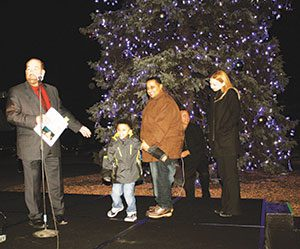 Mayor O'Reilly, Lowrey student light the City of Dearborn Christmas tree