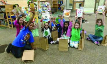 Local student-led organization promotes literacy, offers tutoring