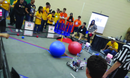 Unis Middle School hosts FIRST tech challenge