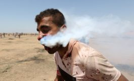 Palestinian hit in face by tear gas canister fired by Israeli soldier in Gaza protests