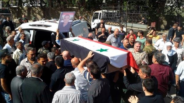 Mouners carry coffins of Syrian Druze victims massacred in Sweida by ISIS terrorists