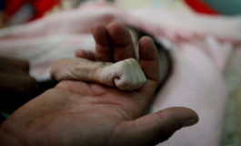 Yemeni father mourns baby girl who died of starvation