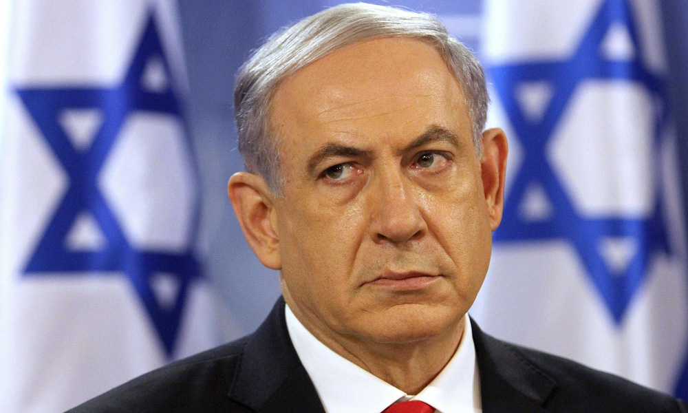 Israeli TV stations showed Netanyahu being escorted off a stage by bodyguards to a shelter after sirens sounded.