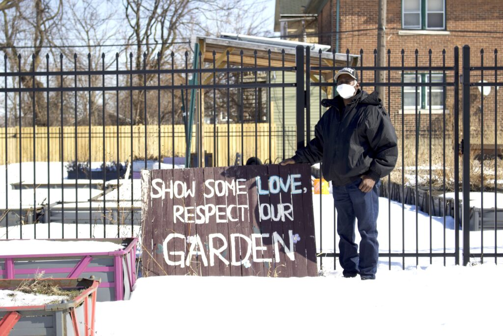HUDA's building manager Donald Ford stands in front of the HUDA Urban Garden, located just a block down from the clinic