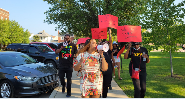 Spa owner Tiara Boyd leads march in front of Hamtramck City Hall on July 27. Photo: Rasha Almulaiki /The Arab American News