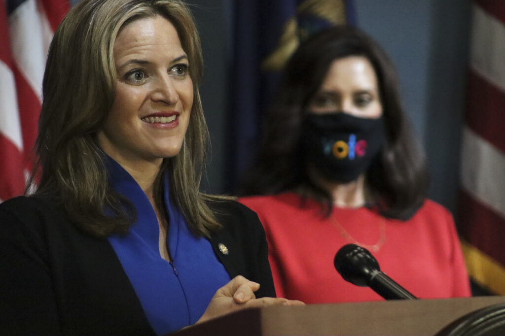 Michigan Secretary of State appears next to Governor Whitmer at a live address from Lansing, Wednesday, Sep. 16. Photo: Office of the Governor