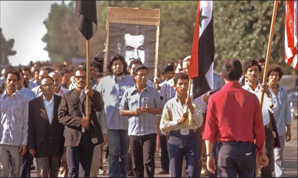Chavez, center, marching with Yemeni activists, Delano, CA, 1973. Courtesy of Bob Fitch Photography Archive, Department of Special Collections, Stanford University Libraries