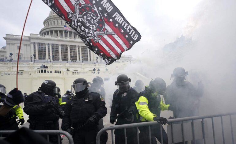 Capitol protests result in more than 50 arrests, 14 officers injured and four deaths; state of emergency extended