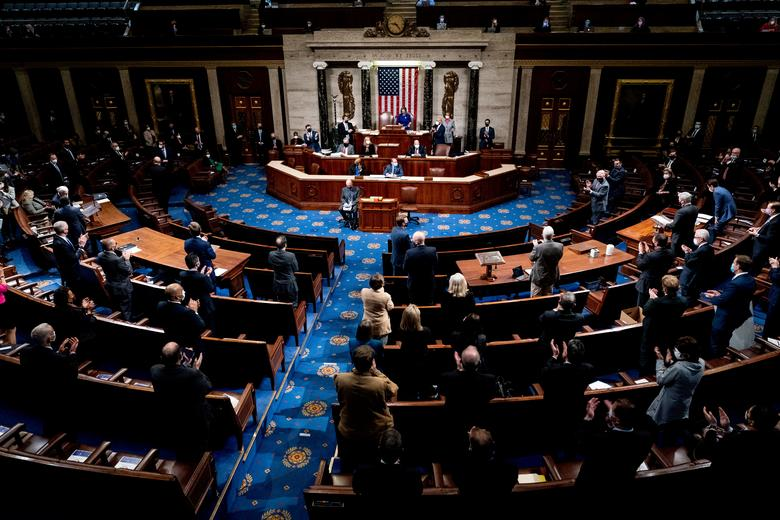 The House chamber reconvenes and condemns the violent riot led by pro-Trump supporters inside the Capitol Building. Photo: Reuters