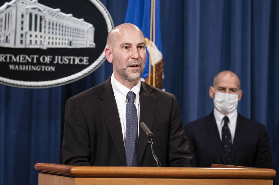 """Steven D'Antuono, head of the Federal Bureau of Investigation (FBI) Washington field office, speaks as acting U.S. Attorney Michael Sherwin, right, listens during a news conference Tuesday, Jan. 12, 2021, in Washington. Federal prosecutors are looking at bringing """"significant"""" cases involving possible sedition and conspiracy charges in last week's riot at the U.S. Capitol. Photo: Sarah Silbiger"""