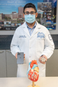 Dr. Singh testing an iPhone against a defibrillator. Photo: Henry Ford Health Systems