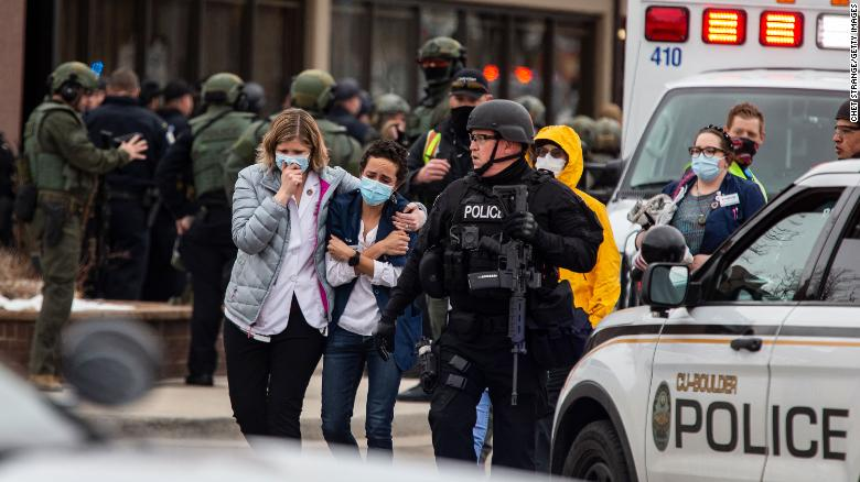 Police escort people at the scene of an active shooter at a grocery store in Boulder, Colorado. Photo: Getty Images