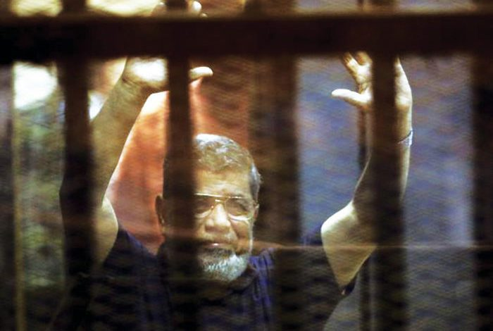 Mohamed Morsi died in court, in a soundproof cage under guards' watch