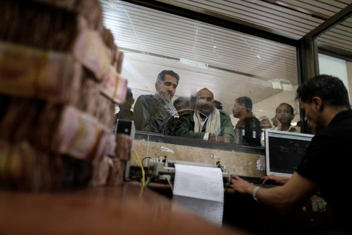 Unpaid government workers deepen economic pain in Yemen's war