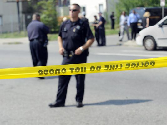 Detroit man executed outside son's school