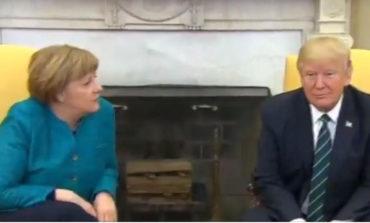 Trump refuses to shake Angela Merkel's hand