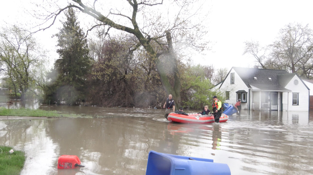 Dearborn Heights firefighters recuing residents trapped in their homes by flood on Tuesday, May 1
