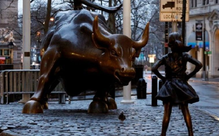 Statue of girl stares down Wallstreet's bull in defiance on Women's Day eve
