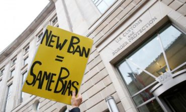 Trump's revised travel ban dealt first court setback