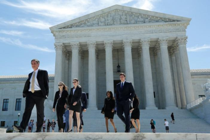 Supreme Court revives travel ban