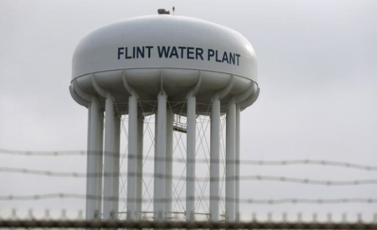 Six Michigan officials charged with manslaughter in Flint water crisis