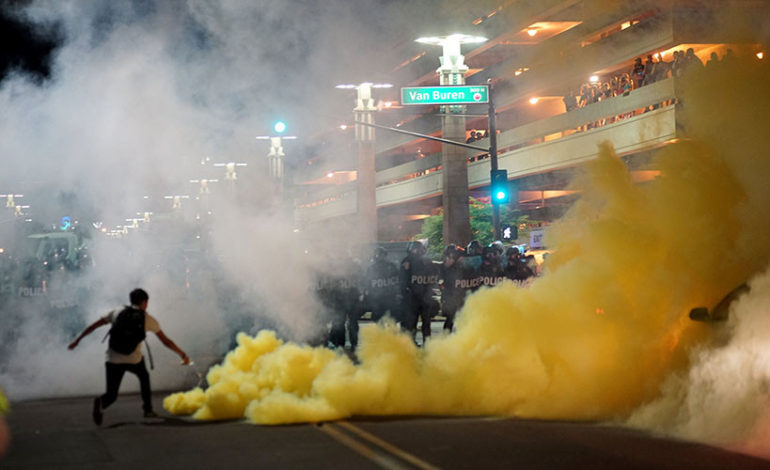 Police use pepper spray to disperse protesters at Trump's Phoenix rally