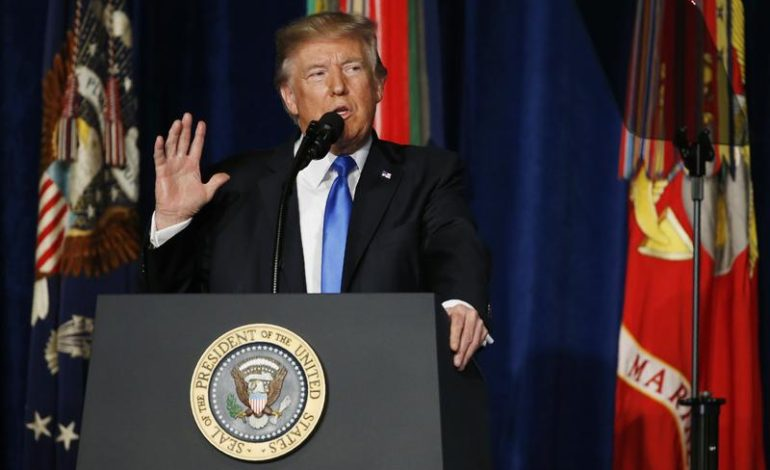 Trump commits U.S. to Afghanistan war; Taliban vow 'graveyard'