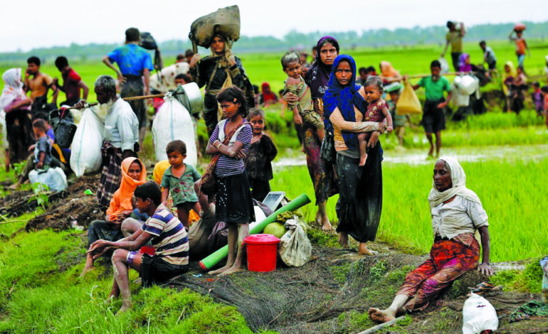 By land, river and sea, Rohingya Muslims make their escape from death