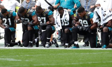 NFL players, managers defy Trump on anthem protests