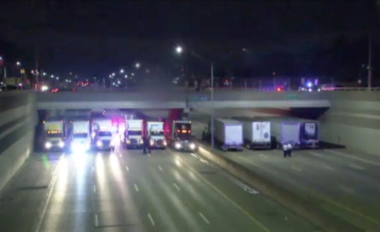 State Police organize 13 semis on I-696 freeway to save suicidal man