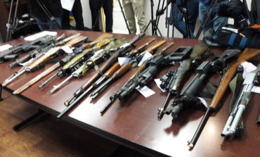 Police officers find weapons, ammo cache during check of licensed dealer