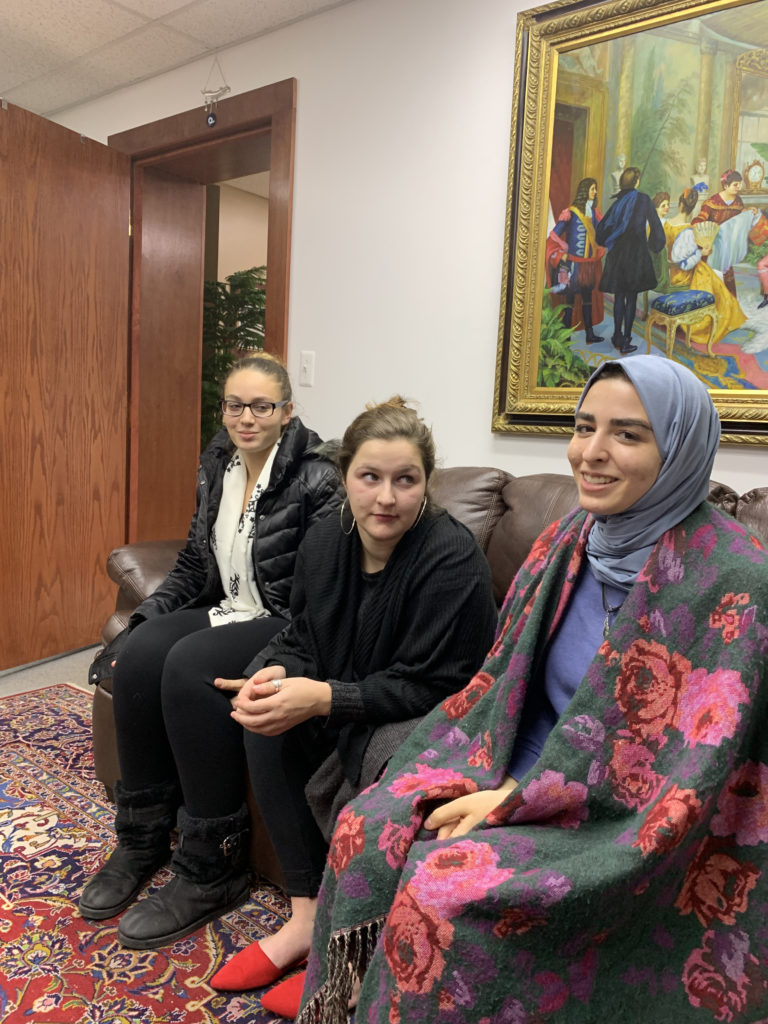 Left to right - SPJ President Jasmine Rabie, Research Chair Jordan Yunker and Vice President Jenin Yaseen speaking with the Arab American News