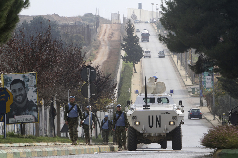 U.N peacekeepers patrol the Lebanese side of the Lebanese-Israeli border in the southern village of Kfar Kila, Lebanon, Tuesday, Dec. 4, 2018.
