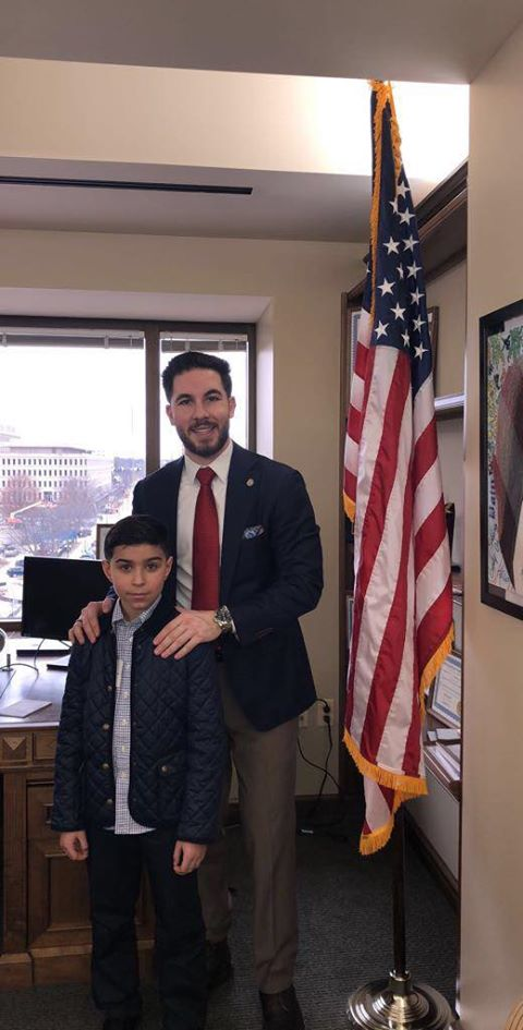 State Rep. Abdullah Hammoud with fourth grader 9-year-old Mahdi Nassrallah during his visit to Lansing