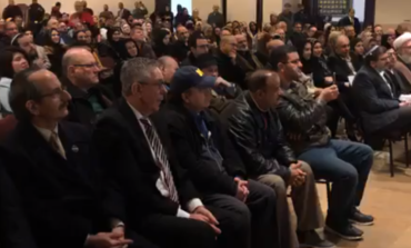 Mourners of New Zealand terror attack victims pack Islamic Center in a show of unity, defiance