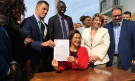 """Gov. Whitmer signs new auto insurance law that could """"significantly lower"""" premiums"""
