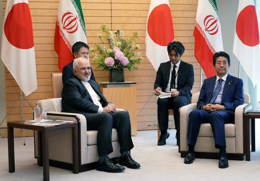 Iranian Foreign Minister Mohammad Javad Zarif, left, and Japanese Prime Minister Shinzo Abe, right, speak at Abe's official residence in Tokyo Thursday, May 16, 2019 - Reuters
