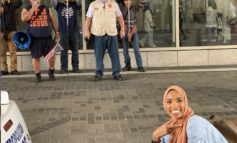 Muslim American posts viral photo in front of anti-Muslim protest