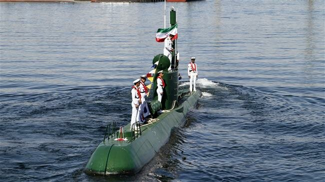 n this photo, Iran's navy members stand on Ghadir-942 submarine in southern port of Bandar Abbas, Iran, at the mouth of the strategic Strait of Hormuz, Nov. 29, 2018. (By Mehr)
