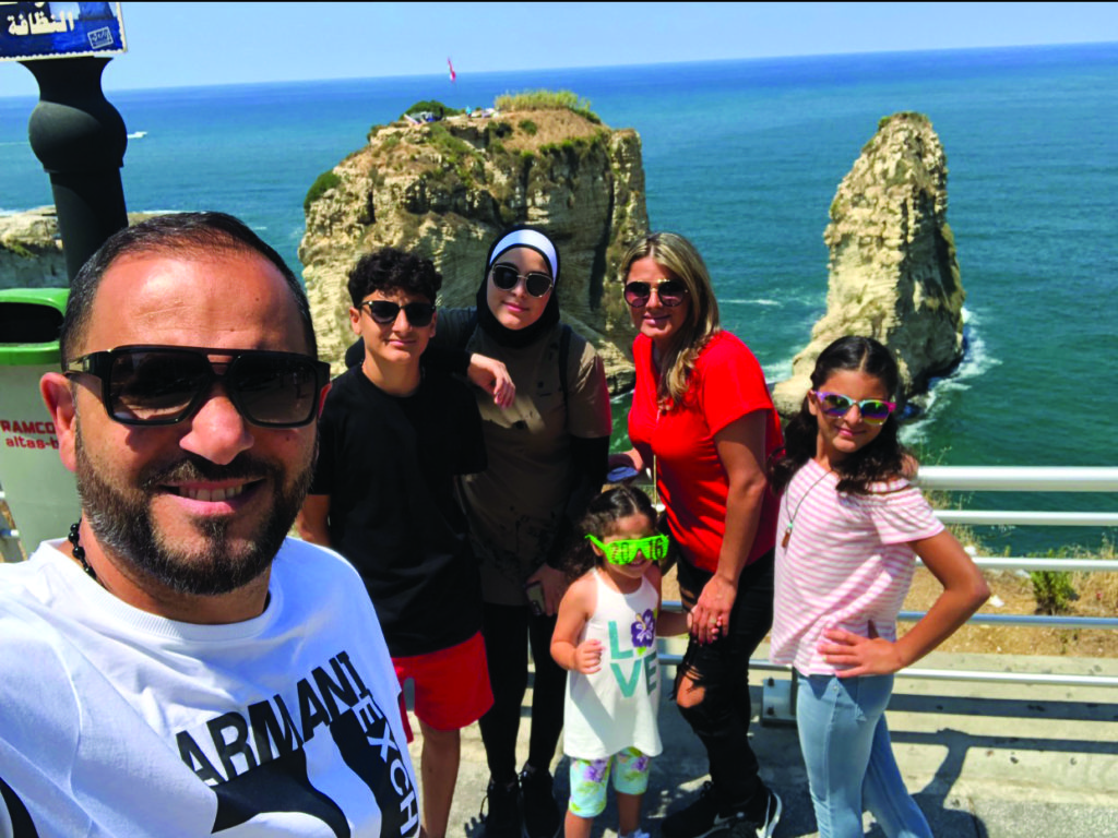 The family of Marwan Faraj, his wife Chirrine, daughters Batoul, Ayat, Lamees and son Mohamad are posing in a selfie and behind them is the iconic rock of Raouche' in Beirut, Lebanon