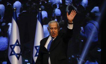 Netanyahu loses ground, calls on Gantz to form unity government