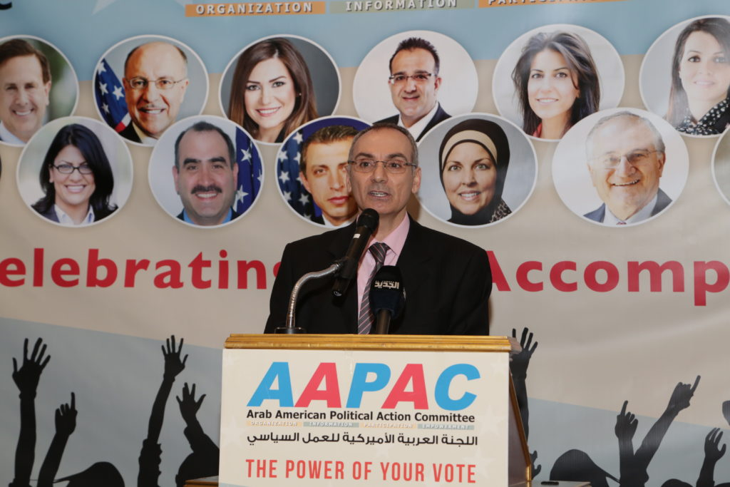 Abed hammoud speaking at one of AAPAC's annual banquet dinners