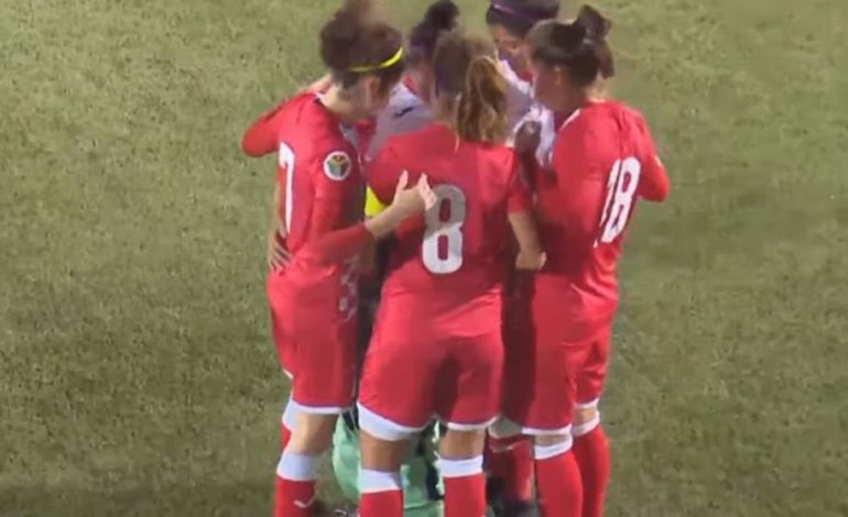 Jordanian soccer team huddles around opposing player during game so she can fix her hijab