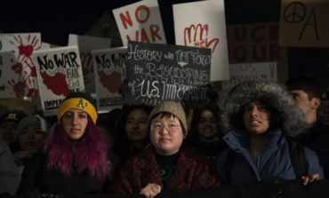 Demonstrators brave freezing temperatures to join anti-war rally  at the University of Michigan