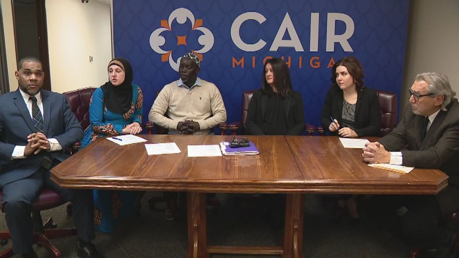 CAIR MI Executive Director Dawud Walid, CAIR attorney Amy Doukoure, plaintiffs / former co-workers Aliou Diao and Alicia Dunlap and their attorneys Channing Robinson and Michael Pitt. - Photo a video grab