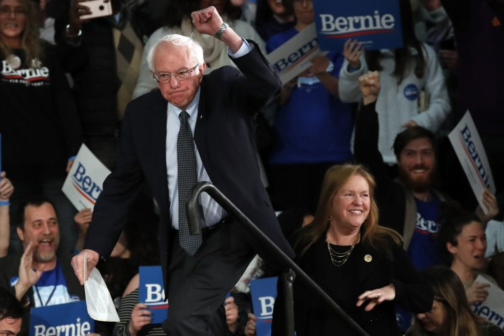 Sen. Bernie Sanders, I-Vt., with his wife Jane O'Meara Sanders, speaks to supporters at a caucus night campaign rally in Des Moines, Iowa, Monday, Feb. 3. -Photo by AP