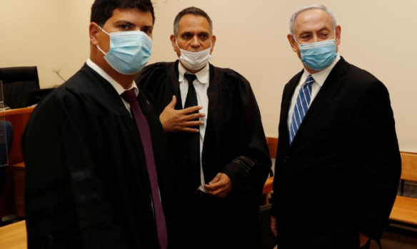 Netanyahu appears in court, becoming first ever Israeli prime minister to be put on trial