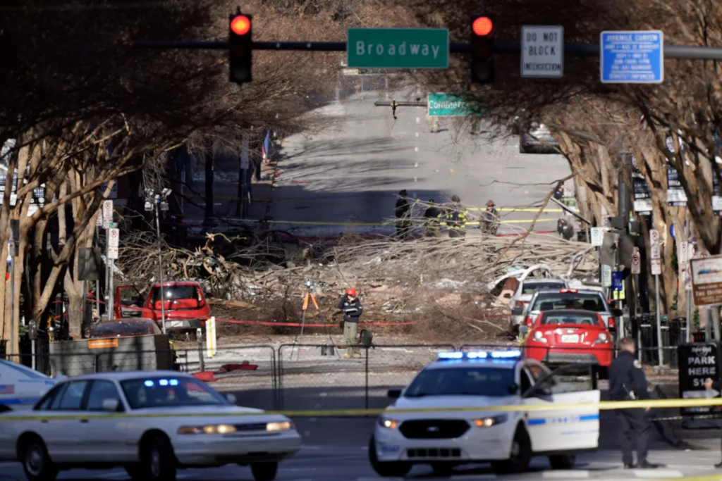 Investigators continue to examine the site of an explosion Sunday, Dec. 27, 2020, in downtown Nashville, Tenn.