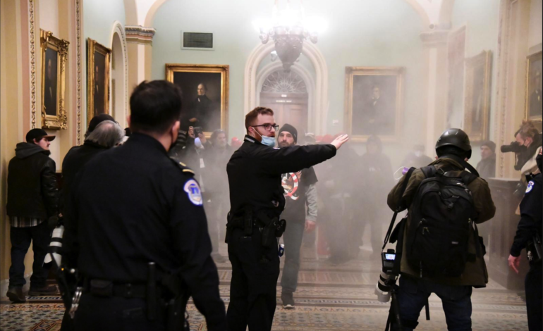 Guns and tear gas in U.S. Capitol as Trump supporters attempt to overturn his loss